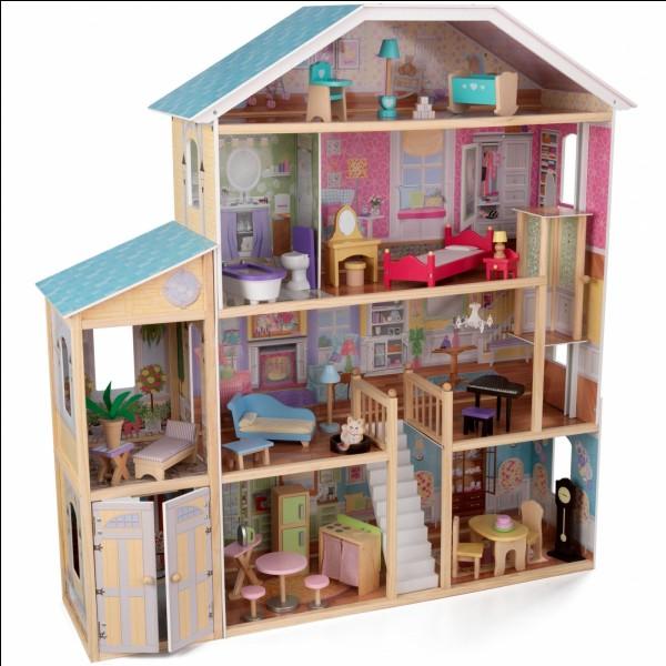 Dans quelle série 5 des personnages principaux se retrouvent-ils(elles) emprisonné(e)s dans une maison de poupées grandeur nature ?