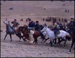 Sport équestre kirghize, qui ressemble au sport de la question N°4, sauf que il faut mettre la carcasse dans un but 5 joueurs par équipe..