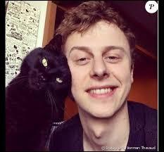 Avant d'avoir Merlin, quel était le nom de l'ancien chat de Norman ?
