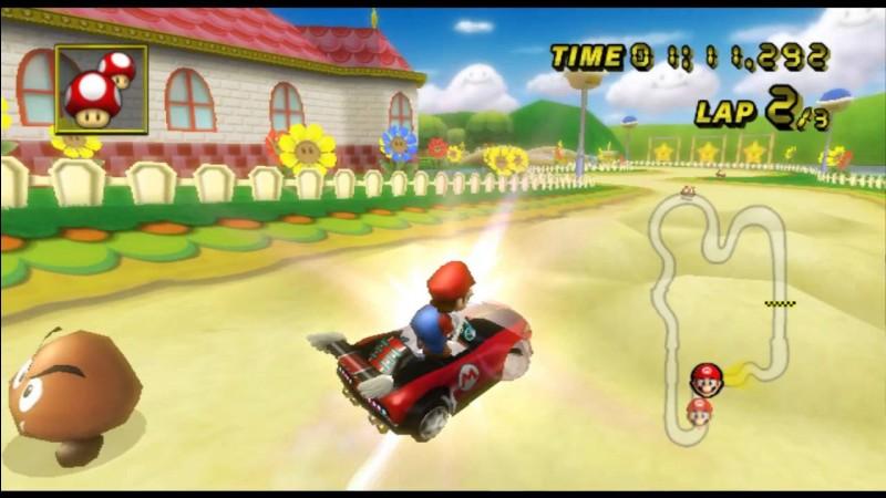 Dans le circuit Mario (Game Cube) qu'y a-t-il sur les piquets en bord de circuit ?