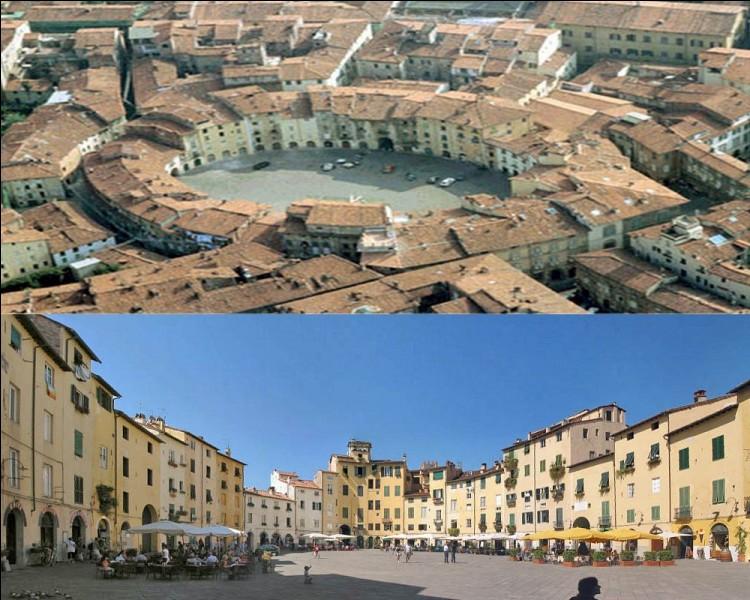 Quelle ville toscane possède une place caractéristique créée sur les ruines d'un amphithéâtre romain du IIe siècle après J.C.?