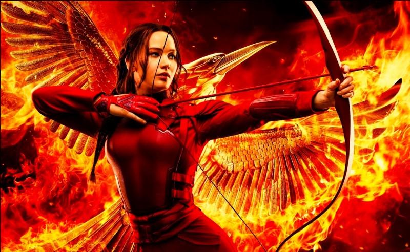 Pour quelle raison Katniss a-t-elle participé aux Hunger Games dans le tome 1 ?