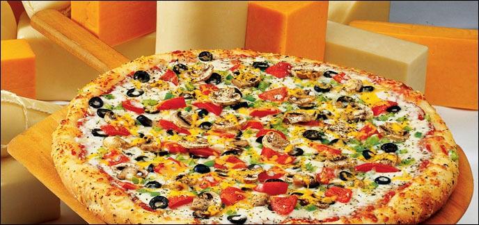 Quel est le poids moyen d'une part de pizza et la taille moyenne d'une pizza en France ?