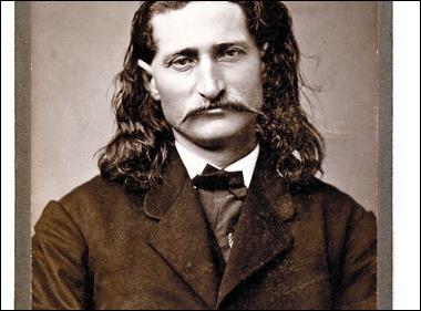Reconnu comme exceptionnel au pistolet. Pendant la Guerre (1861-1865), il s'engage dans l'armée de l'Union. C'est là qu'il gagne son surnom à cause de ses exploits.C'est un maître du maniement des revolvers. En 1867, il tue 3 hommes et en blesse un autre dans un saloon : comme shérif, il tua 3 soldats et une autre fois, il tua son assistant. En jouant au poker, il est salement tiré dans le dos.