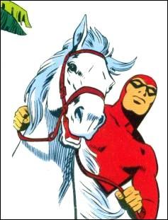 Il est le premier justicier à porter un survêtement rouge de la tête aux pieds, montrant ses muscles tel un lutteur masqué. Il est le descendant de plusieurs générations de justiciers.Il est souvent avec ''Héros'' son cheval et ''Satan'', son chien.