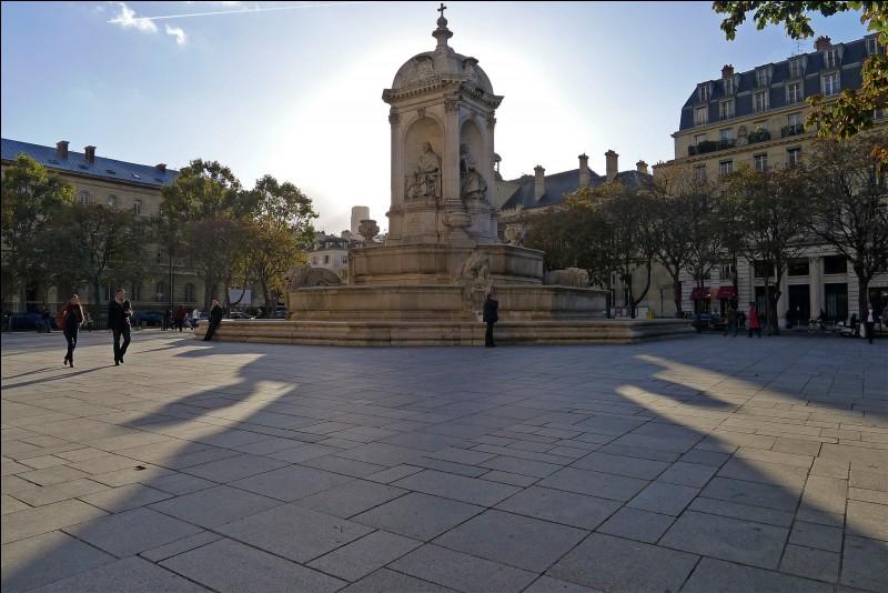 """Comment s'appelle cette place possédant en son centre une fontaine surnommée """"fontaine des quatre points cardinaux"""" ?"""