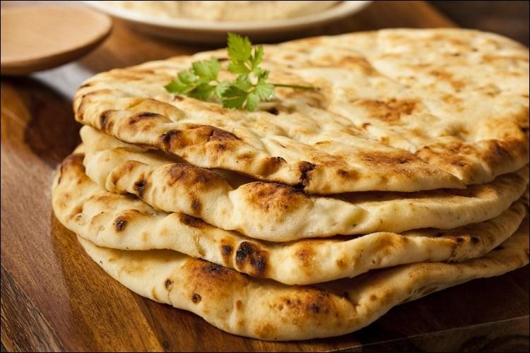 Feuille mince de pain, faite de fariné de blé et cuite sur les parois d'un four, couramment consommé en Iran, Afghanistan, Ouzbékistan, Pakistan et Inde.