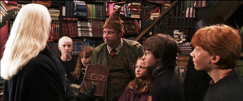Que se passe-t-il entre Mr Weasley et Mr Malefoy dans la librairie Fleury et Bott ?