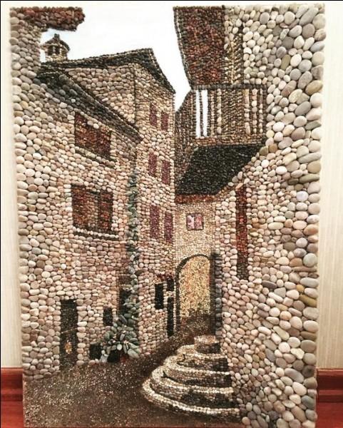 Dans quel département est le pittoresque village médiéval de Pérouges ?