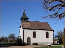 Nous sommes maintenant en Bourgogne-Franche-Comté devant la chapelle Sainte-Brigitte-et-Saint-Roch d'Eguenigue. Nous nous trouvons dans le département ...