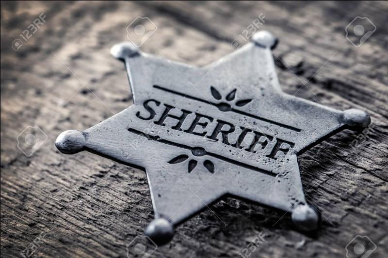 Les shérifs américains portent une étoile parce que les petites villes américaines ne disposaient pas des moyens nécessaires pour réaliser des plaques en forme de bouclier, avec armoiries, comme dans les grandes cités américaines.