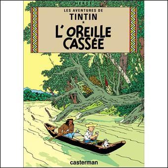 """Quel est le nom du sculpteur de bois qui meurt au début de l'album """"L'Oreille cassée"""" ?"""