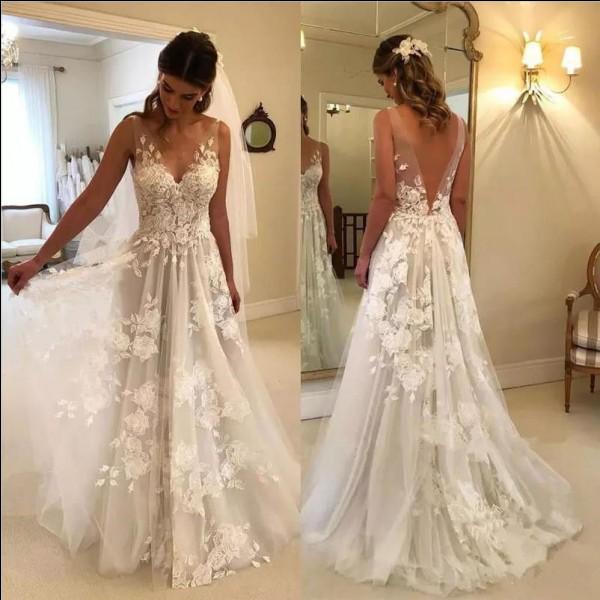"""""""Qu'elle est belle, qu'elle est belle dans sa robe de mariée""""... On finit avec cette chanson de :"""