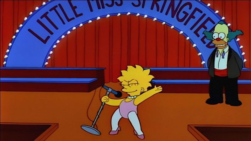 Comment s'appelle la première fille de la famille Simpson ?