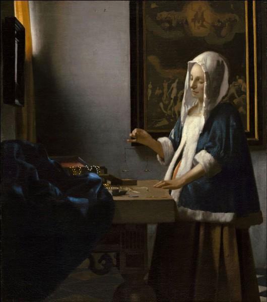 """Quel peintre hollandais du XVIIe est l'auteur du tableau """"La Femme à la balance"""" ?"""