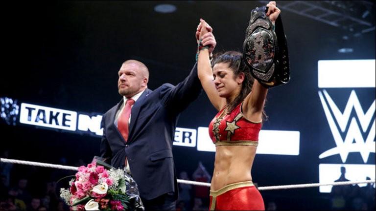 Dans quel Takeover Bayley a-t-elle écrit l'histoire avec Sasha Banks, en participant au tout premier Iron Women match féminin, pour le titre féminin de NXT ?