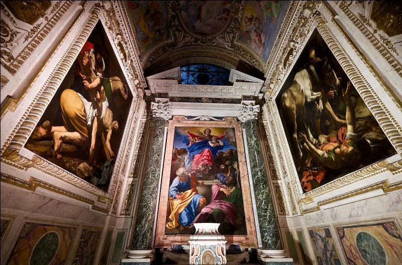 Deux des toiles les plus célèbres de Caravage ornent la Chapelle Cerasi de l'église Santa Maria del Popolo, à Rome, en flanquant un tableau réalisé par un peintre rival. Quel est le nom de ce rival ?