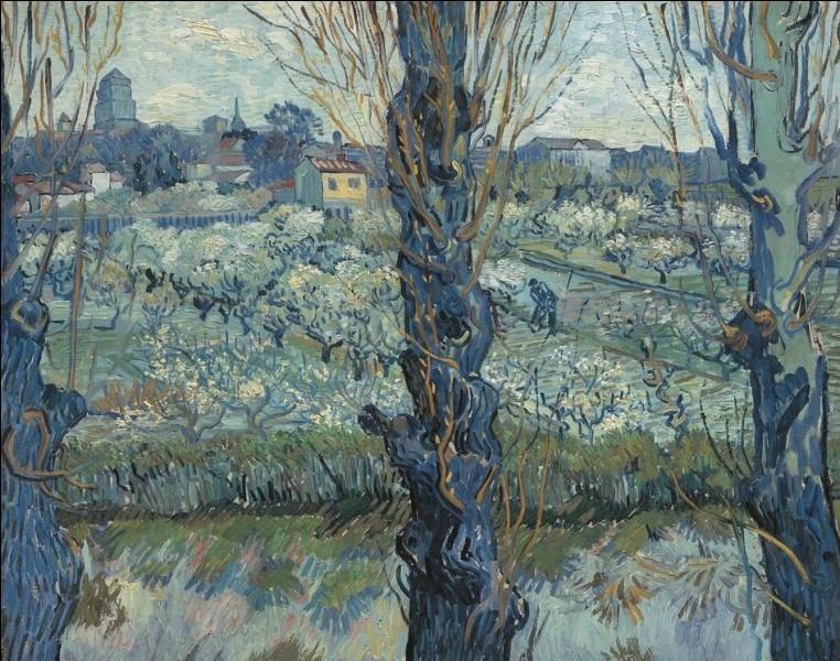 """Qui a réalisé le tableau """"Verger en fleurs avec vue d'Arles"""" ?"""