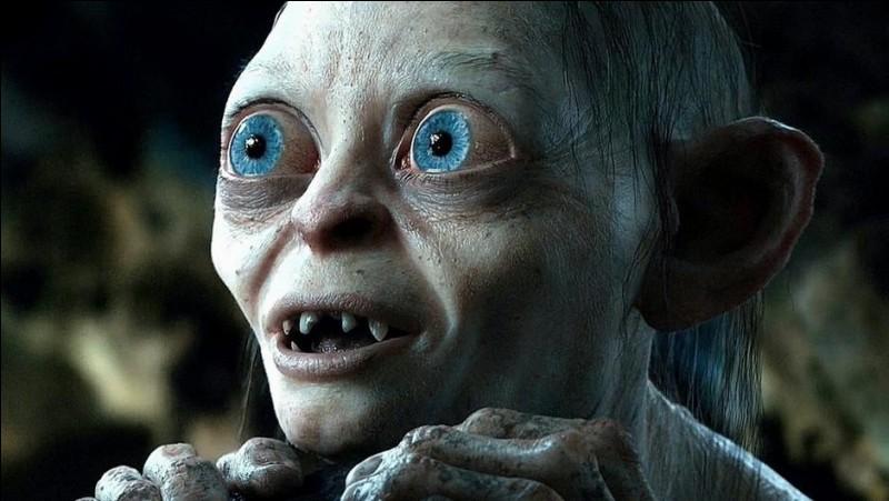 Espèce : Hobbit Famille : Ami de DéagolDescription : Courbé, peau pâle, yeux rondsÀ savoir : Tient son nom du bruit de déglutition qu'il fait avec sa gorgeQuel est ce personnage ?