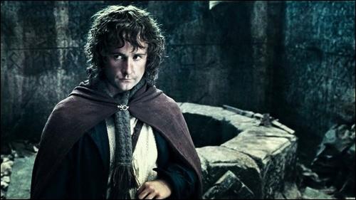 Espèce : Hobbit Famille : Fils de Paladin Description : Petit, grands pieds, cheveux blonds et bouclésÀ savoir : Il meurt au Gondor et est enterré à côté d'Aragorn Quel est ce personnage ?