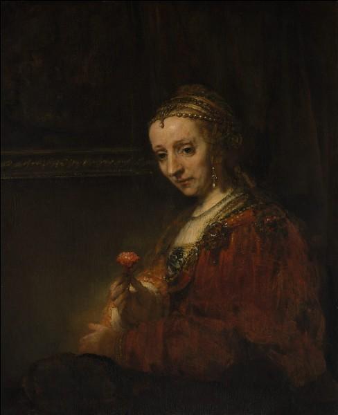 """Quel peintre hollandais du XVIIe est l'auteur du tableau """"Femme avec une rose"""" ?"""