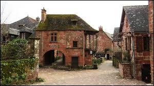Quel est le nom de ce village de Corrèze contenant des maisons au grès rouge ?
