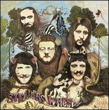 Le groupe Stealers Wheel a chanté ''Stuck in the Middle with you''. Que signifie le mot ''stuck'' ?