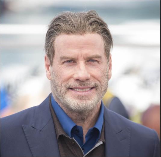 Qui est ce John, acteur américain, chanteur, danseur et producteur de cinéma ?