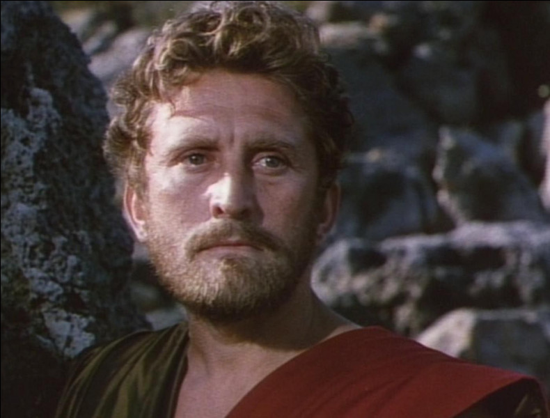 De retour chez lui en quoi Ulysse se déguisa-t-il pour passer inaperçu ?