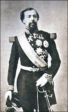 Il est de la Maison Grimaldi. ''En 1885, son effigie figure sur la première émission de timbres-poste de Monaco, remplaçant les timbres de France''.Quel est le roi qui à la perte de Menton et Roquebrune, autorisa la création d'un casino pour regarnir les finances ?