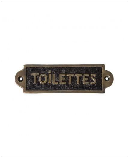 Où Bébel a-t-il mis la pancarte ''Toilettes'' quand Togo lui demande où elles se trouvent ?