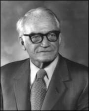 En 1964, Lyndon B. Johnson (démocrate) bat largement Barry Goldwater (républicain). Qu'est-ce que défendait celui-ci s'il était élu ?