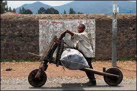 Comment s'appelle cette grande trottinette utilisée particulièrement en République démocratique du Congo ?