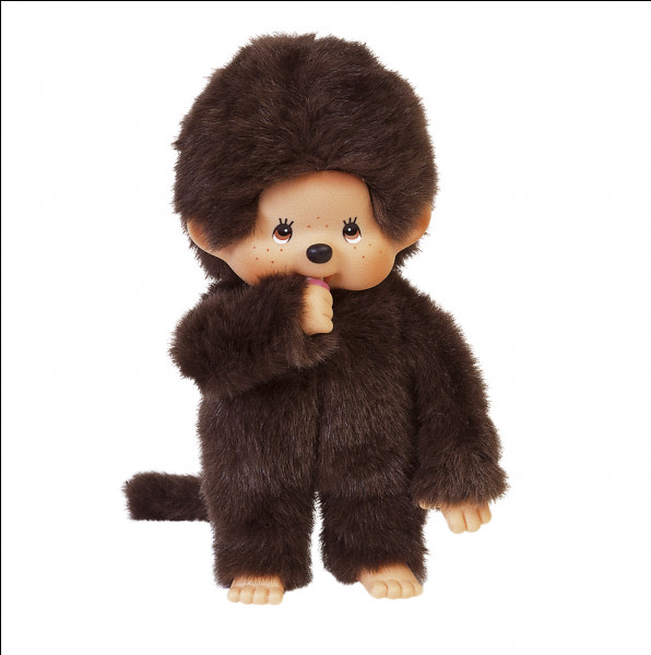 Quel est le nom de cette peluche représentant un petit singe avec une tête ronde et une tétine à la main ?