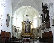 Classée en monument historique, la collégiale Saint-Sauveur de Grignan a été construite au début du XVIe siècle (en 1526 très exactement). Cependant, un élément a été réalisé quelque dizaines d'années plus tard, en 1662. Savez-vous de quoi il s'agit ?