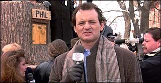 Quelle est la première réaction de Phil quand il doit refaire le reportage sur la marmotte :