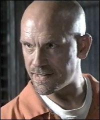 Le meneur des mutins est joué par John Malkovich. Quel est le nom de son personnage ?