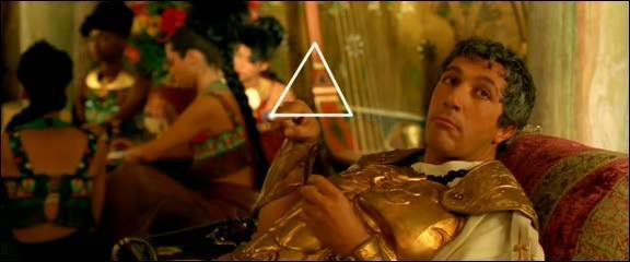 Dans quel film Alain Chabat trouva-t-il le moyen de se mettre le costume de Jules César et de tourner un scène torride avec Monica Bellucci ?