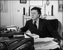 À quel mouvement appartenant l'écrivain André Breton ?