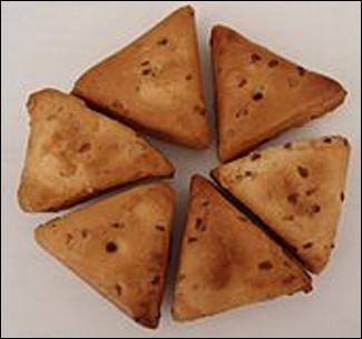 Quel est ce biscuit à l'anis, très ferme et de forme triangulaire , spécialité de Carmaux ?