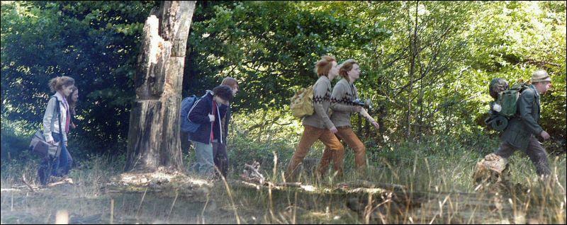 Par quel moyen Harry et les Weasley parviennent-ils à l'endroit où doit se dérouler la 422ème Coupe du Monde de Quidditch ?