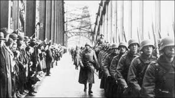 07 mars 1936 : Prenant prétexte de la ratification, le 27 février, du traité d'assistance mutuelle signé en mai 1935 par la France et l'URSS, quelle région du Rhin le führer fait-il traverser à trois bataillons de la Wehrmacht, qui rentrent dans la plupart des villes de ce lieu ?