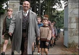 """Dans le film """"Les Choristes"""", quel est le métier du personnage incarné par Gérard Jugnot ?"""