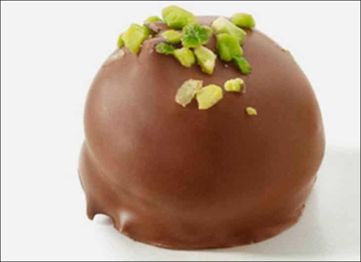 Friandise belge en forme de coque en chocolat noir, chocolat au lait, chocolat blanc ou au caramel, garnie d'une crème à base de crème fraîche et de sucre. La crème peut être aromatisée au café, à la pistache, au caramel, etc.