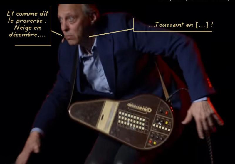Cet artiste protéiforme est doté d'une belle voix de baryton. Mais quel est l'instrument bizarre avec lequel il s'accompagne ?