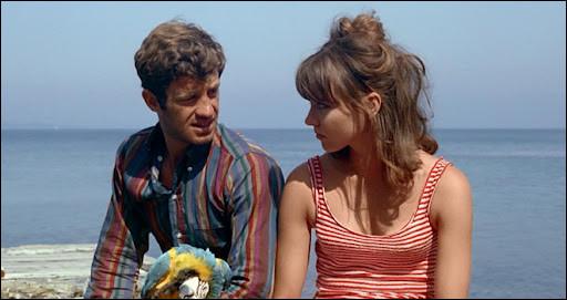 Dans ce troisième film tourné avec Godard, il est Ferdinand Griffon, qui décide de tout quitter et de partir avec Marianne (Anna Karina) vers le sud de la France : c'est ...