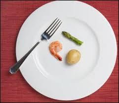 Quelqu'un qui mange très peu a un appétit de...