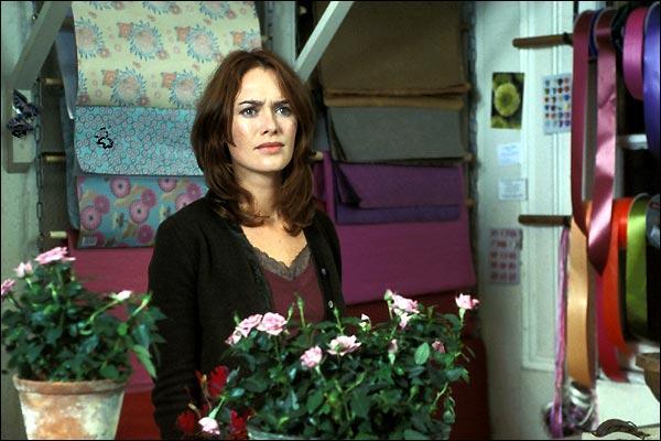 Dans quel film le personnage interprété par Piper Perabo tombe amoureux de cette femme ?
