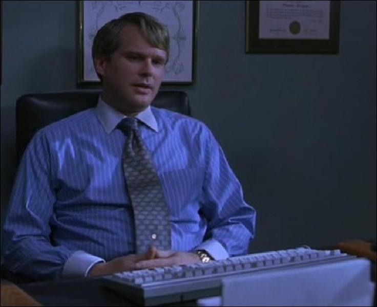 Quel est le métier de Lawrence Gordon, joué par Cary Elwes ?