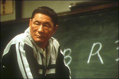 Dans Battle Royale où est-ce que Nobu blessa Takeshi d'un coup de couteau à la sortie des cours ?